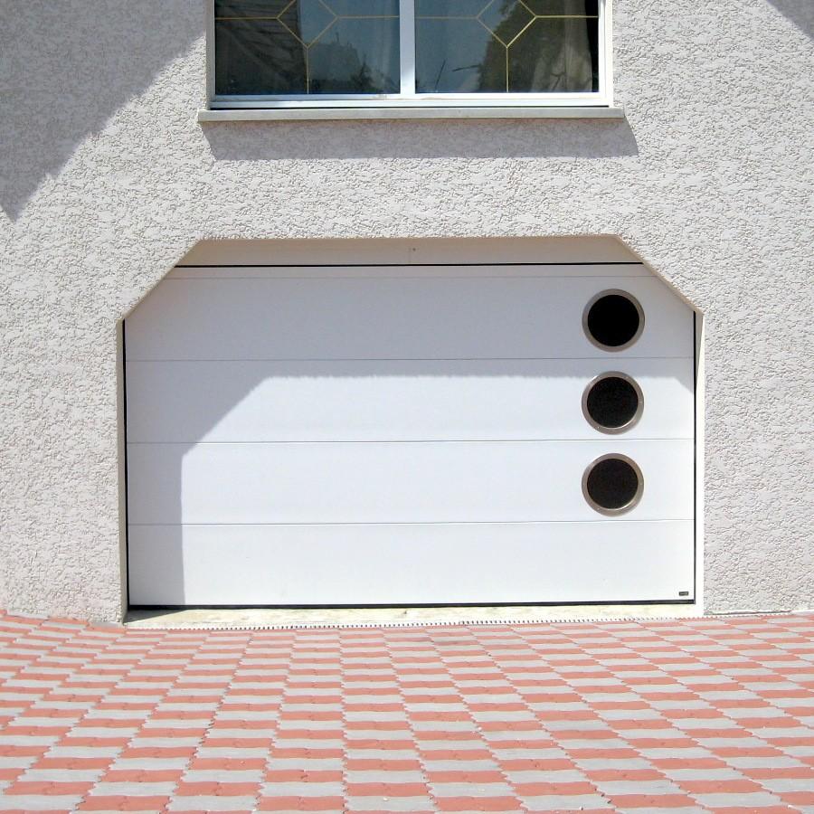 Porte de garage sectionnelle isolante 40mm for Porte de garage sectionnelle spadone
